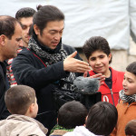 Goto speaks to children in AleppKenji Goto captured and broadcast the voices of children in war-torn areas. Here, he speaks to children in Aleppo, northern Syria. Photo: Japan Timeso, northern Syria. Photo: Japan Times