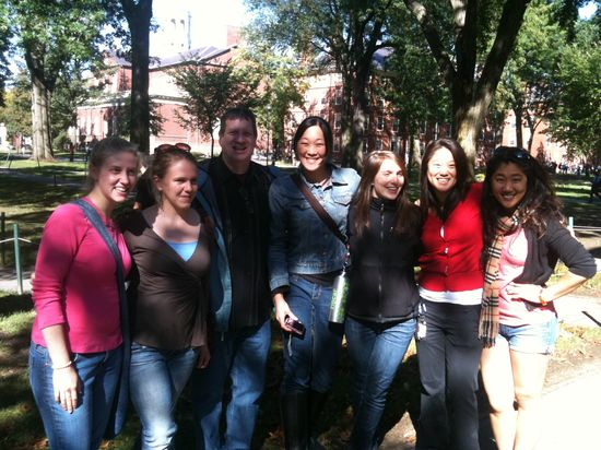 A group of Harvard University InterVarsity students smile with Strobel, who attended the Spiritual Heritage Tour with Biola in 2010.