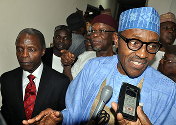 Presidential candidate of Nigeria's main opposition party, the All Progressives Congress (APC,) General Muhammadu Buhari (R), flanked by vice-presidential nominee Professor Yemi Osibajo (L) speaks at APC headquarters in Abuja on December 17, 2014. Nigeria's opposition party on Wednesday chose Yemi Osibajo, a Christian pastor and ex-Lagos state justice commissioner, as its vice presidential nominee for February 14, 2015, polls, in a move to reach across religious lines in this deeply divided country. Former military dictator Muhammadu Buhari last week secured the All Progressives Congress (APC) presidential nomination to challenge incumbent Goodluck Jonathan. AFP PHOTO / STRINGER
